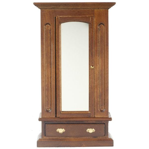A dollhouse furniture armoire in a walnut finish.
