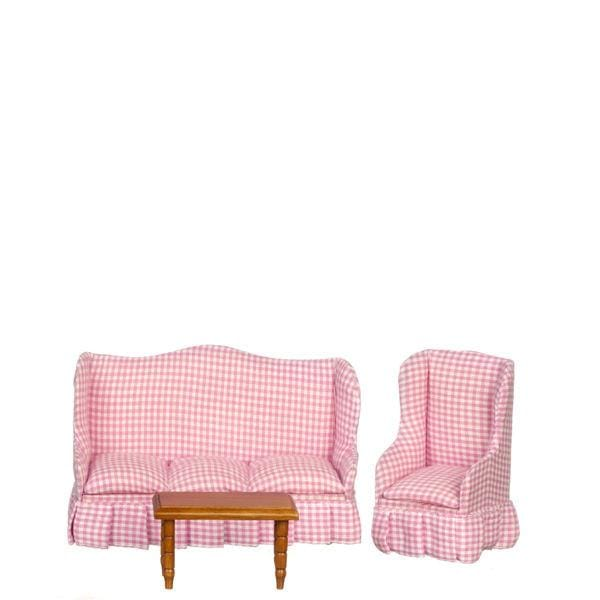A dollhouse furniture set that includes a red gingham sofa and chair and a wood coffee table.