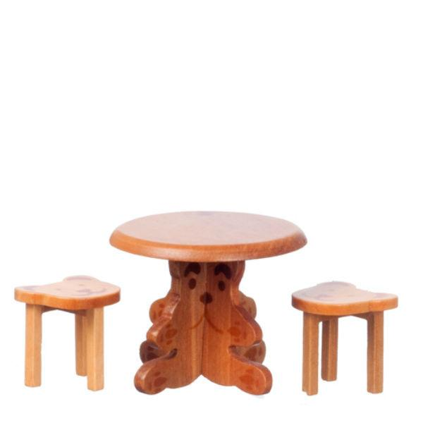 A dollhouse miniature kids' table with two stools.