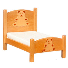 A dollhouse furniture kids' bed with two wood teddy bears on it.