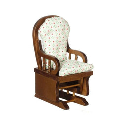 A dollhouse furniture gliding rocker with a polka dot print.