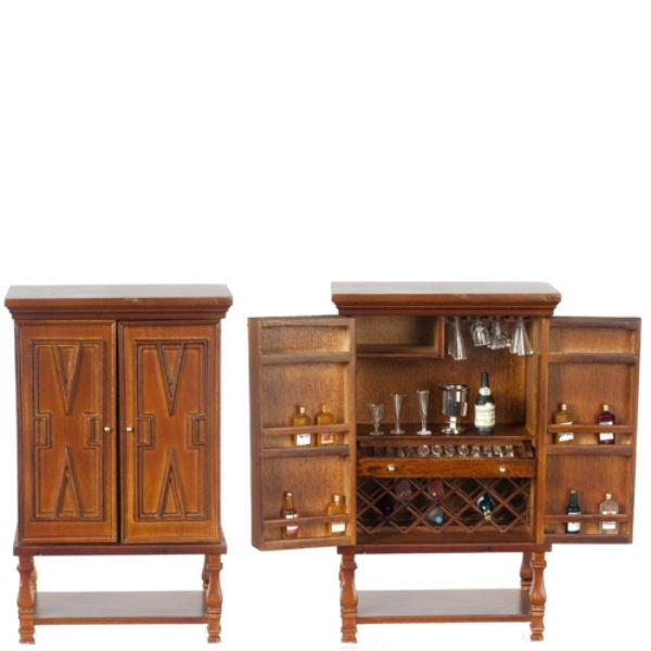 A dollhouse furniture bar cabinet that is stocked with glasses and alcohol.