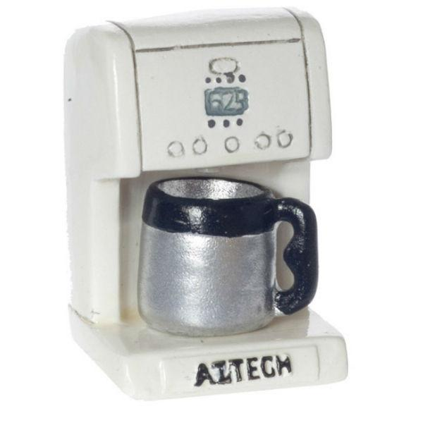 A white dollhouse miniature coffee maker.