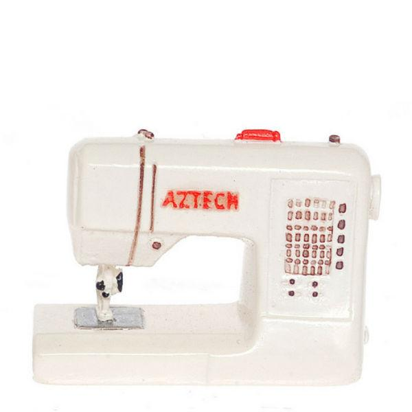 A modern dollhouse miniature sewing machine.