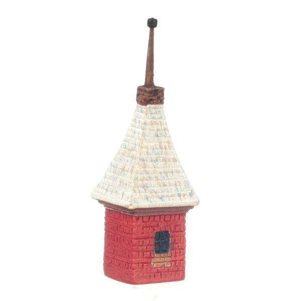 A dollhouse miniature birdhouse modeled after a Russian cottage.