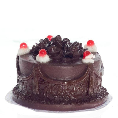 A dollhouse miniature chocolate cake.