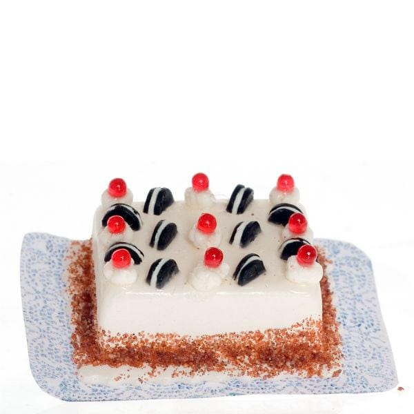 A dollhouse miniature cake with Oreos in it.