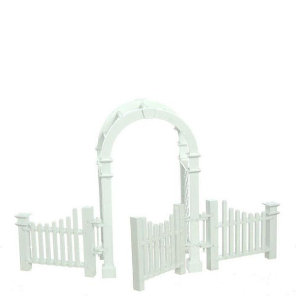 A white dollhouse miniature arbor, gate, and fence.