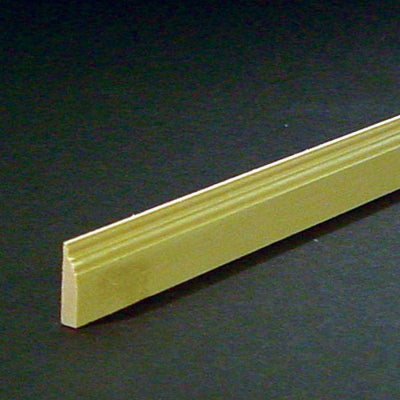 A piece of dollhouse miniature baseboard.