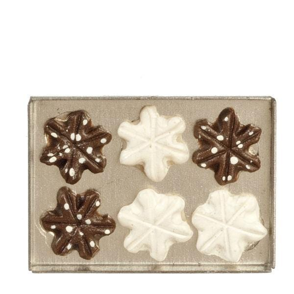 dollhouse miniature snowflake cookies on a tray
