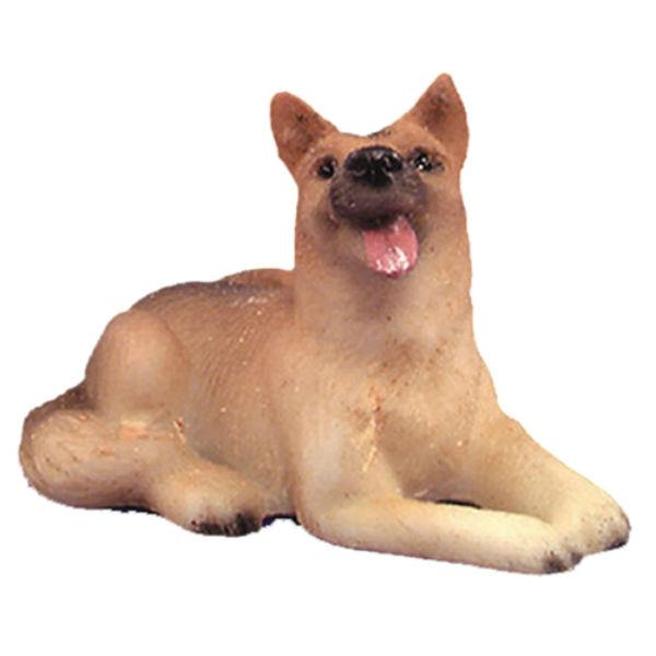 dollhouse miniature dog that is a sitting german shepherd