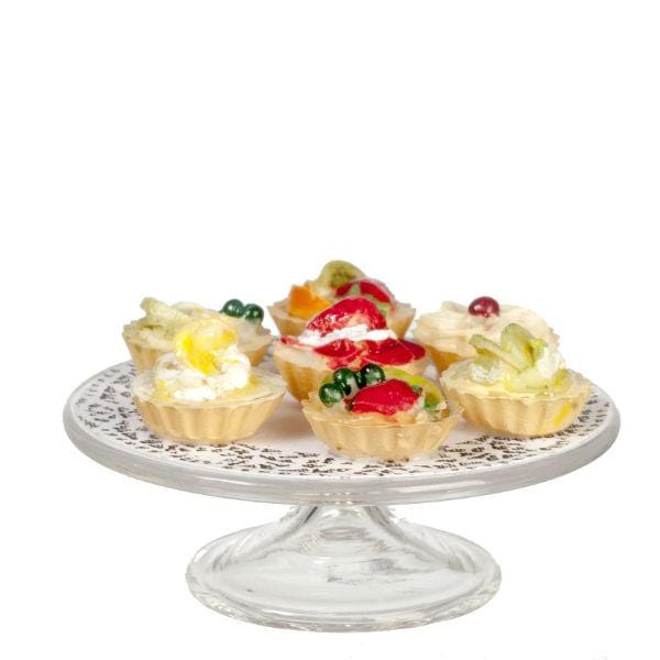 dollhouse miniature fruit tarts on a plate
