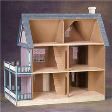 The back of a farmhouse wood doll house.