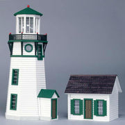 Miniature half scale lighthouse with keeper's house.