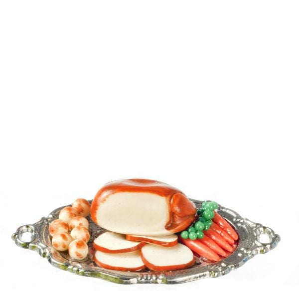 A dollhouse miniature turkey dinner on a platter.