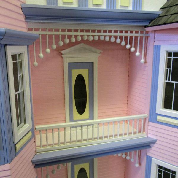 Wood painted lady dollhouse.