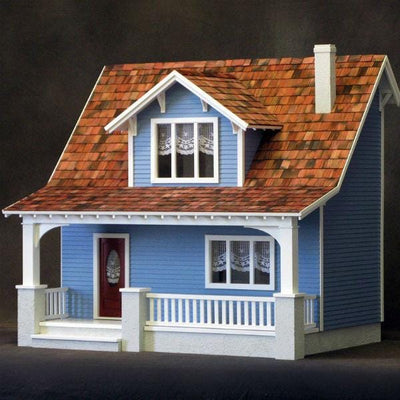 A wooden dollhouse kit that is a replica of a Craftsman beach bungalow.