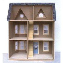 The interior of an assembled wooden dollhouse kit.