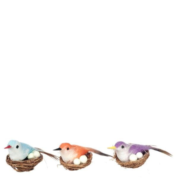 three dollhouse miniature birds in nests