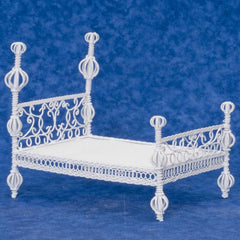 white metal dollhouse bed