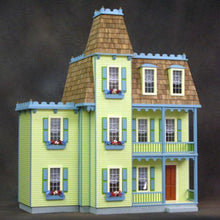 A wood dollhouse with an addition.
