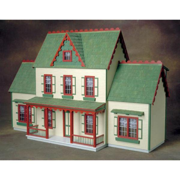 Wood dollhouse with two additions.