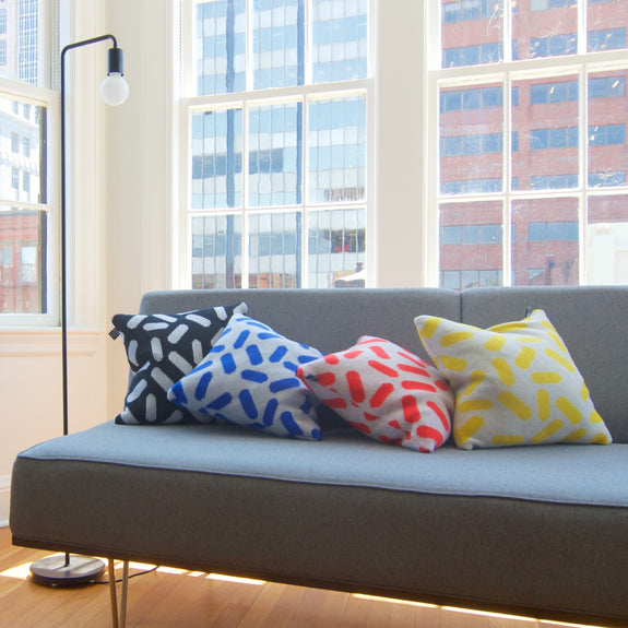 Multicolored Tic-Tac Cushions on Sofa