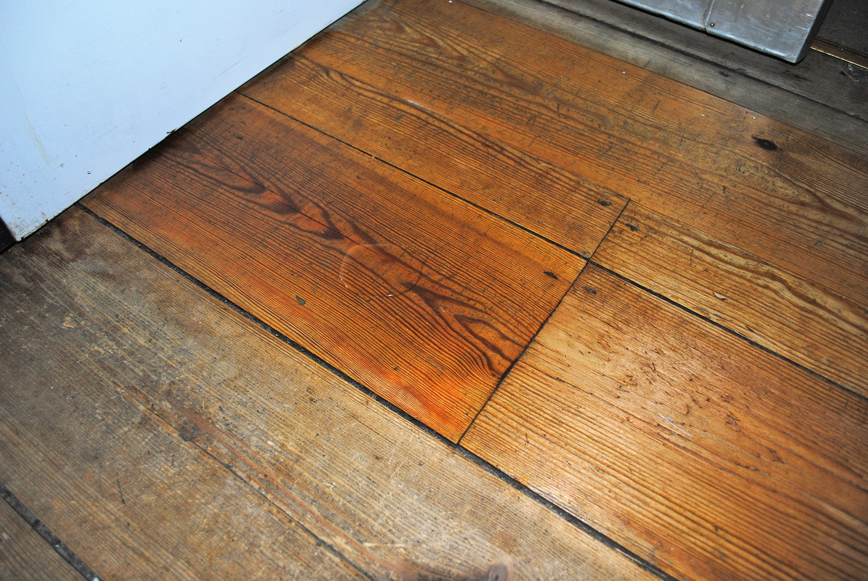 Allback Linseed Oil Wax to rejuvenate wooden floors.