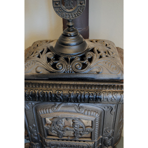 Section of cast iron wood stove rejuvenated with Allbäck Linseed Oil Stove Blacking Fireplace Paint.