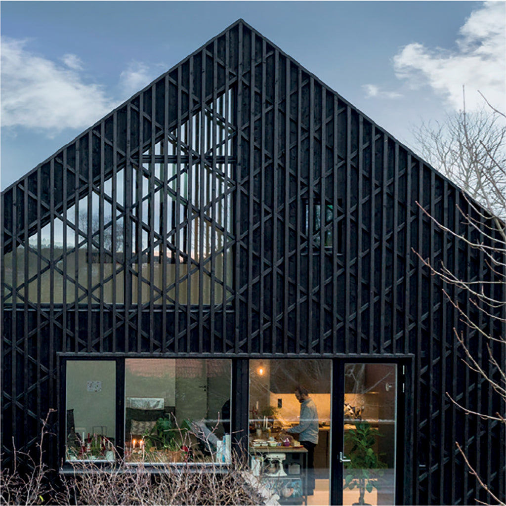 Black-Brown Pine Tar on this modern house a good alternative to Shou Sugi Ban technique.