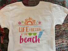 "Women's T-shirt ""Life is Better at the Beach"""
