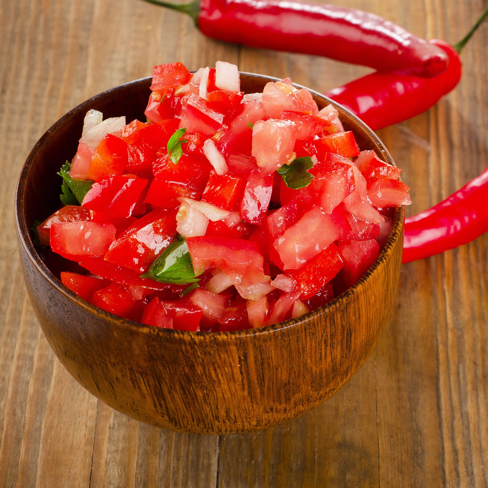 fresh pico de gallo in a wooden bowl