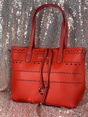 Red laser cut tote style purse