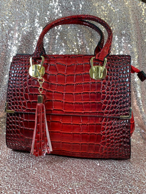 Red Alligator style pursewith tassle trim