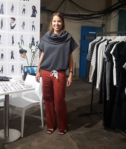 Mathilde from sustain your style in our dark grey GOTS organic cotton poncho