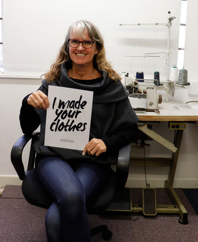 Mims, ethical fashion maker, holding 'I made your clothes' sign.