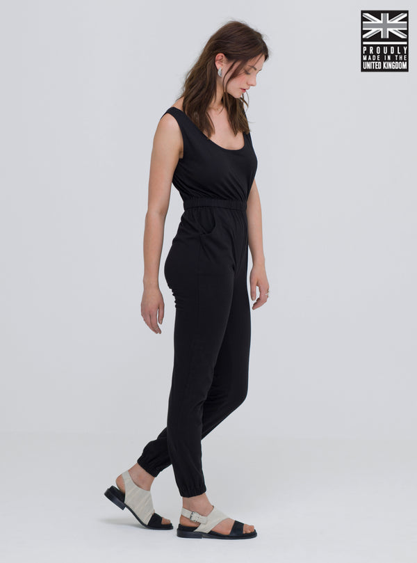 Women wearing minimal style sustainable fashion one piece cotton jumpsuit. This loungewear jumpsuit is made ethically in the UK.