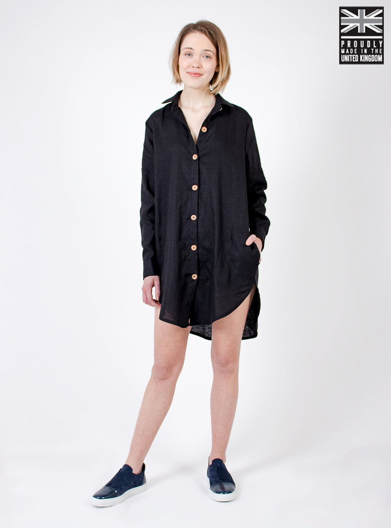 Model wearing black shirt dress. Ethically made in the UK. Minimal style, part of our sustainable fashion collection.