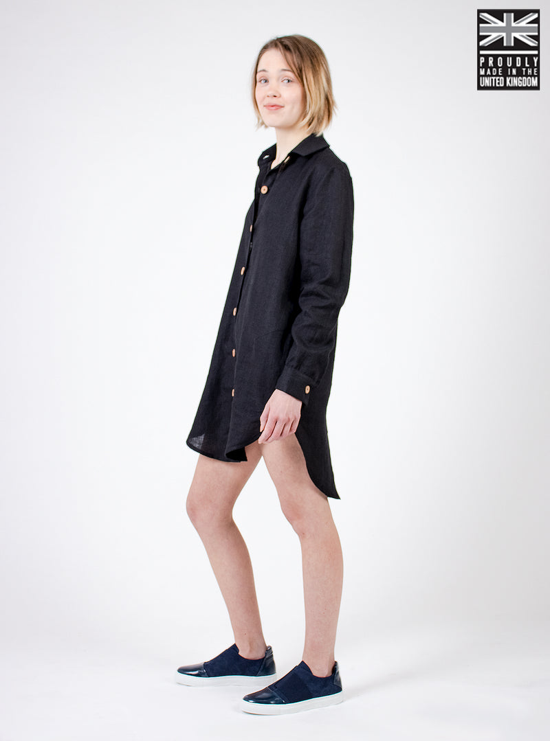 Model wearing black linen shirt dress. Ethically made in the UK. Minimal style, part of our sustainable fashion collection.