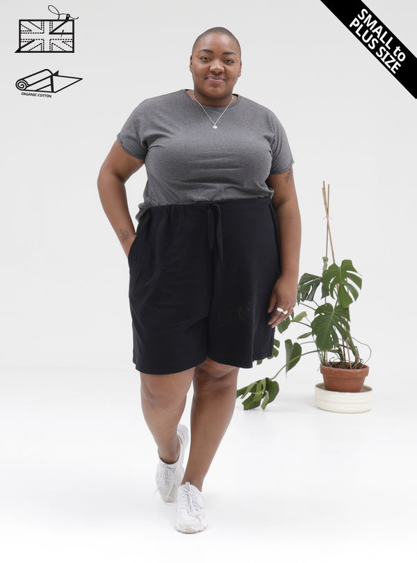 Model wearing zola amour ethical slow fashion organic cotton short culottes in black - available in plus size.