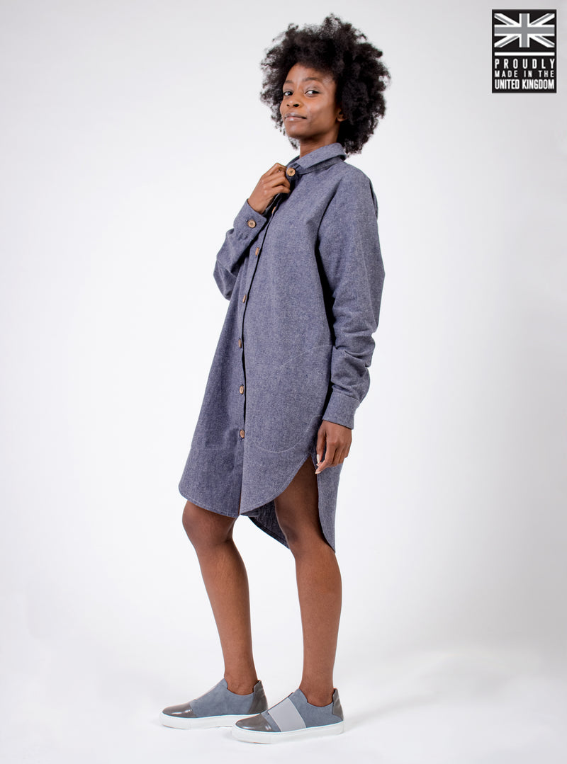 Woman wearing blue recycled hemp shirt dress with waist belt. Ethically made in the UK. Minimal style, part of our sustainable fashion collection.