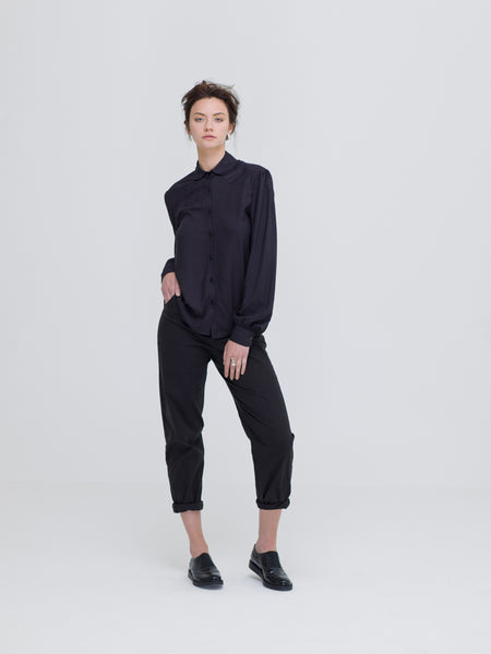 Model wearing Zola Amour's affordable Ethical clothing, black bamboo shirt. Part of the minimalist capsule wardrobe collection.
