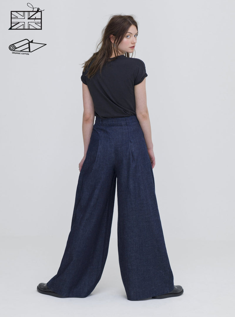 Model wearing Zola Amour organic cotton denim trousers. Ethically made in the UK.