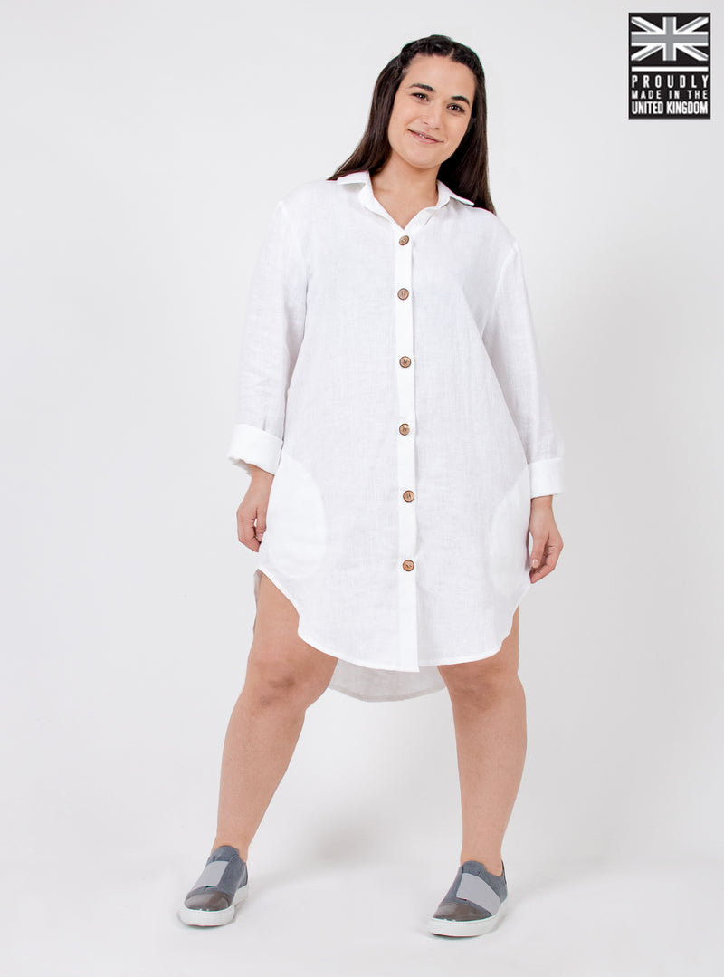 Woman wearing white linen shirt dress. Ethically made in the UK.