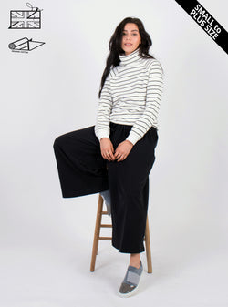 model wearing zola amour, ethical fashion, white and black stripey organic cotton jumper. Available in plus size.
