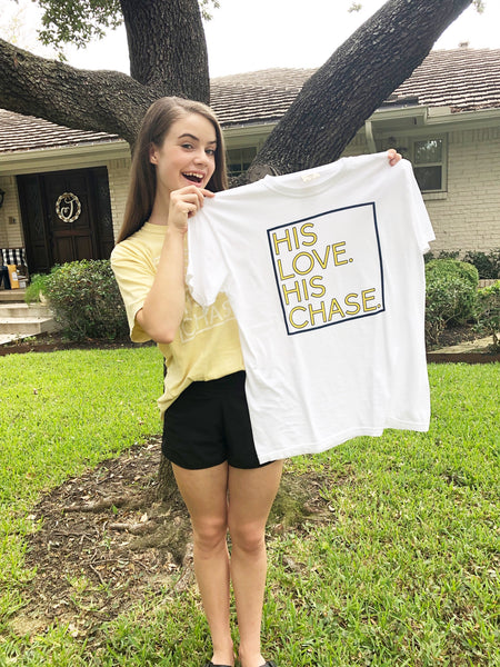 """His Chase. His Love."" White Tee with Navy and Yellow"