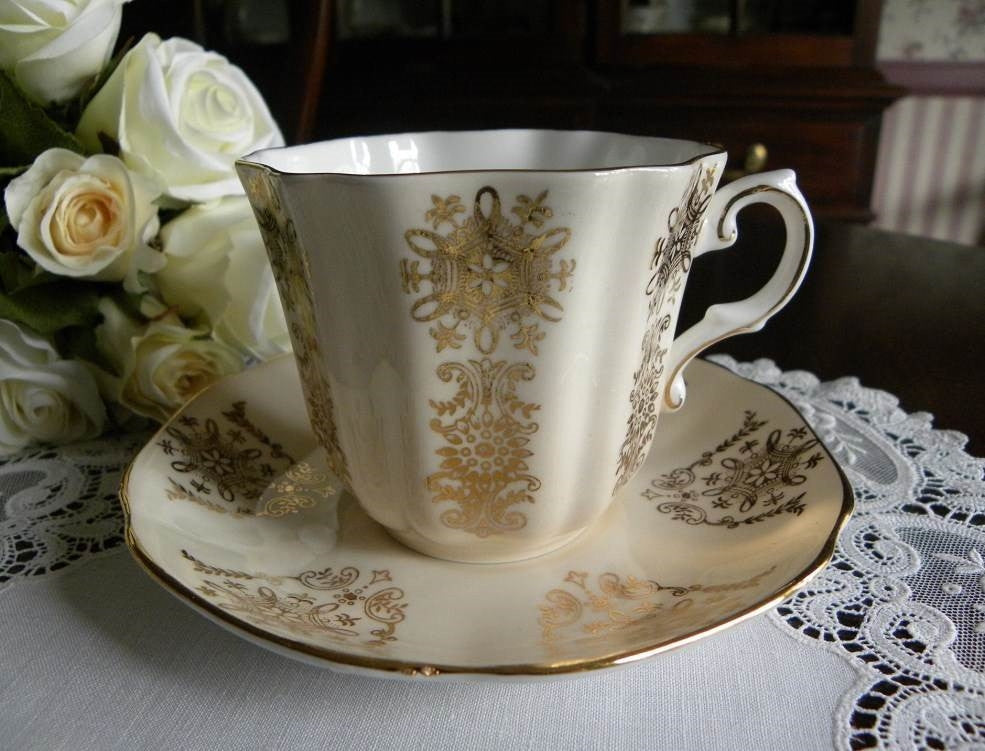 Vintage Creamy Peach with Gold Accents Teacup and Saucer - The Pink Rose Cottage
