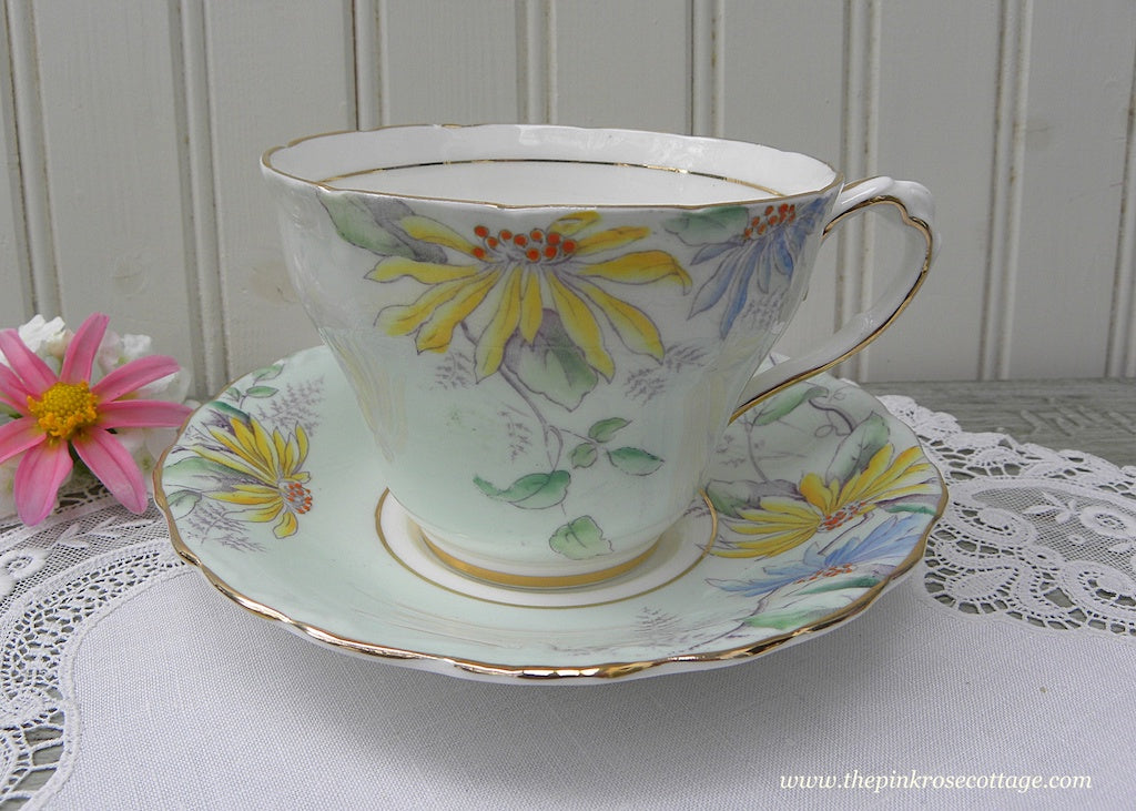 Vintage Paragon Soft Green Teacup and Saucer with Colorful Sunflowers