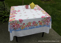 Vintage Pink Carnation Foxglove Lilies and More with Blue Tablecloth