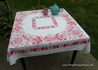 Vintage Pink Petunias and Daisies with Jadite Green Tablecloth